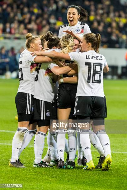 Players from Germany celebrate scoring the opening goal during a womens international friendly between Sweden and Germany at Friends arena on April 6...
