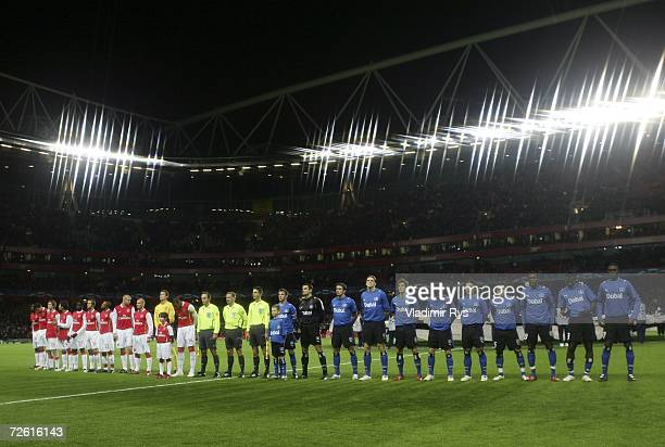 Players from Hamburg SV and Arsenal pose for a picture before the UEFA Champions League Group G match between Arsenal and Hamburg SV at The Emirates...