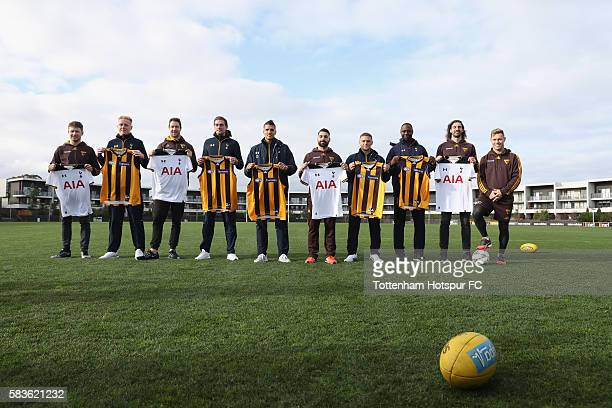 Players from Hawthorn and Tottenham Hotspur pose for the media during a Tottenham Hotspur player visit to the Hawthorn Hawks AFL team at Waverley...