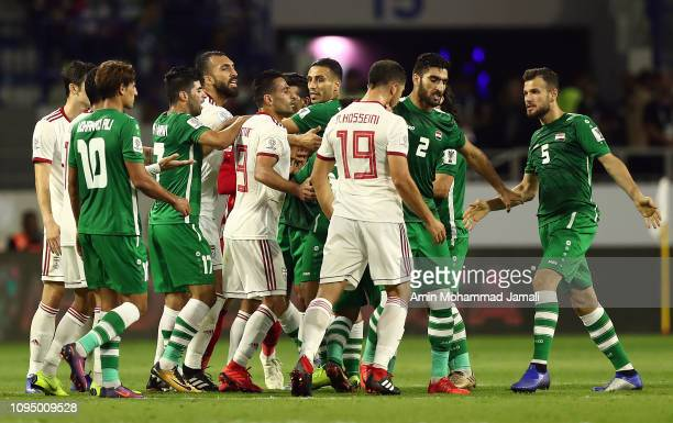 Players from Iran and Iraq react during the AFC Asian Cup Group D match between Iran and Iraq at Al Maktoum Stadium on January 16 2019 in Dubai...
