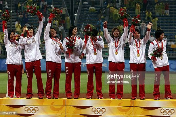 Players from Japan receive their gold medals after they beat the United States 3-1 during the women's grand final gold medal softball game at the...