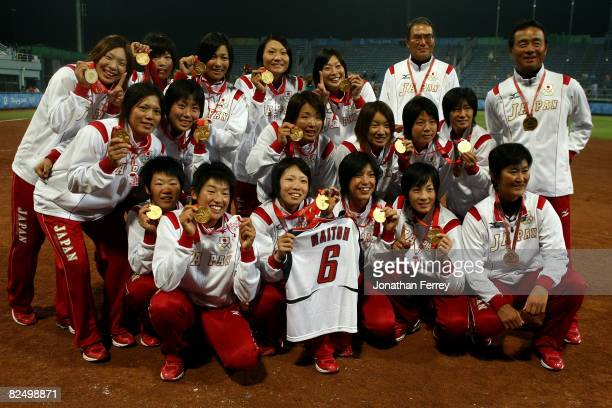 Players from Japan receive their gold medals after they beat the United States 31 during the women's grand final gold medal softball game at the...