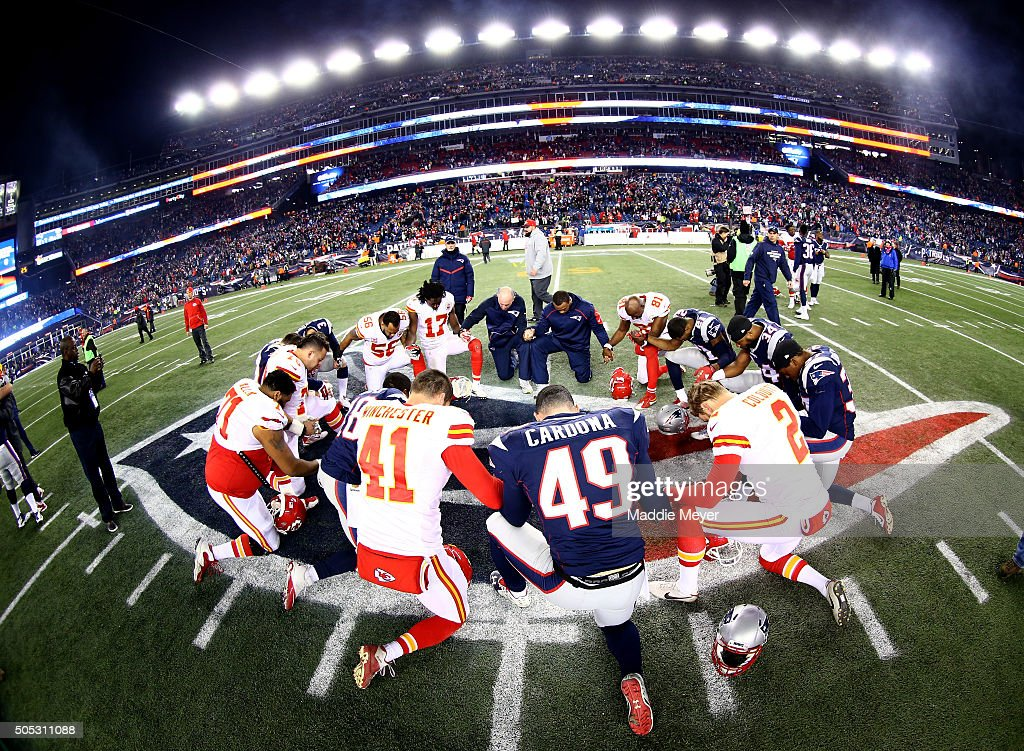 Players from Kansas City Chiefs and New England Patriots gather at mid-field after the AFC Divisional Playoff Game at Gillette Stadium on January 16, 2016 in Foxboro, Massachusetts. The Patriots defeated the Chiefs 27-20.