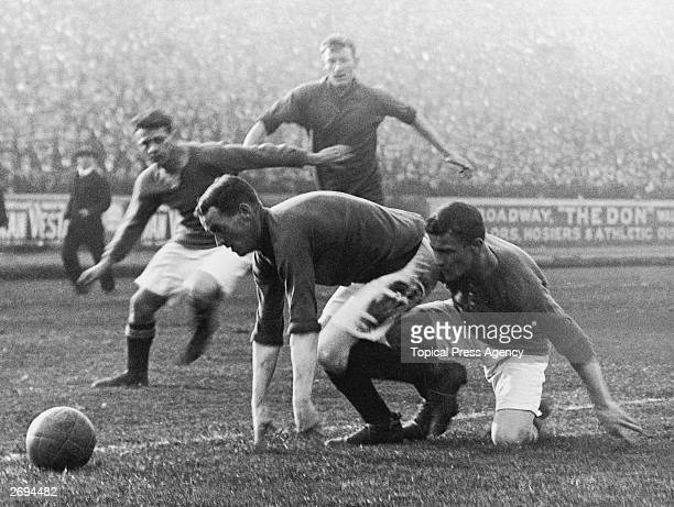 Players from Liverpool and Chelsea compete for the ball during a game at Stamford Bridge