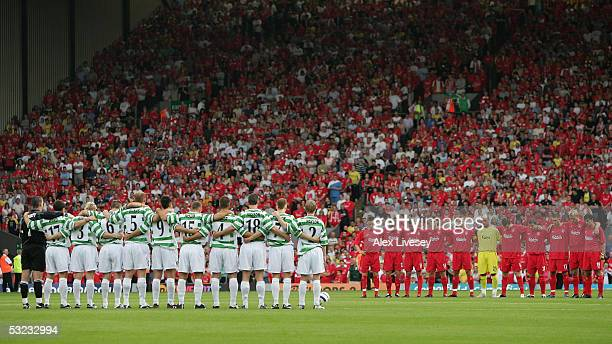 Players from Liverpool and TNS observe a one minutes silence in memory of the people who lost their lives in the London bombings before the UEFA...