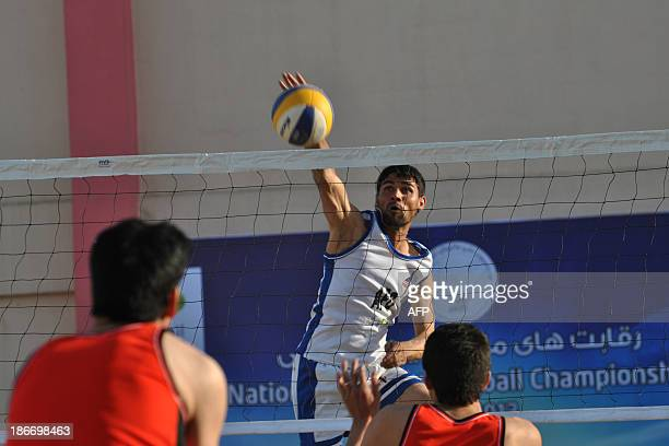 Players from local Afghan teams compete in a fiveday beach volleyball tournament in Kabul on November 3 2013 Some 32 teams from across the country...