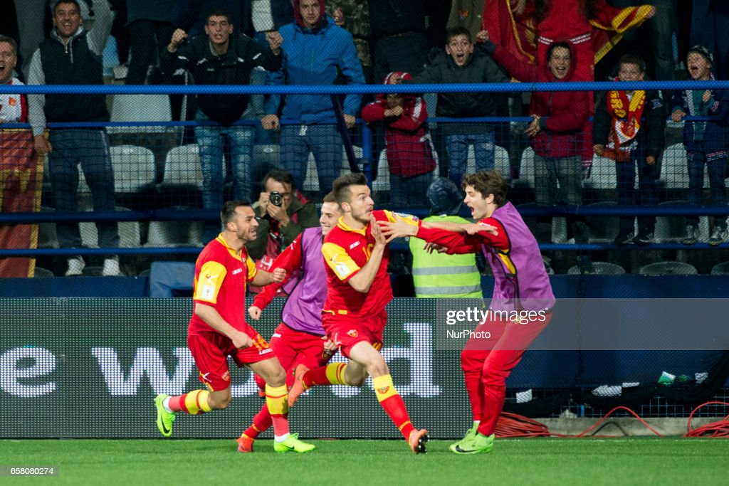 Players from Montenegro celebrate after Stefan Mugosa goal during the FIFA World Cup 2018 Qualifying Round Group E match between Montenegro and Poland at Gradski Stadion in Podgorica, Montenegro on March 26, 2017