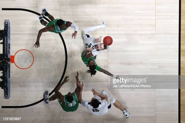 Players from North Texas Mean Green and Purdue Boilermakers fight for a rebound in the first round of the 2021 NCAA Division I Mens Basketball...