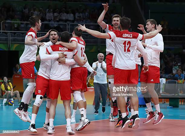 Players from Poland celebrate a victory against Argentina during the men's qualifying volleyball match on Day 6 of the Rio 2016 Olympic Games at the...