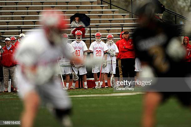 Players from Regis Jesuit High School look on during a CHSAA 5A boys lacrosse semifinal game against Arapahoe on May 15 in Denver Colorado Arapahoe...