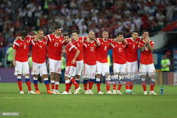 Players from Russia look on from the half way line during the penalty shoot out during the 2018 FIFA World Cup Russia Quarter Final match between...
