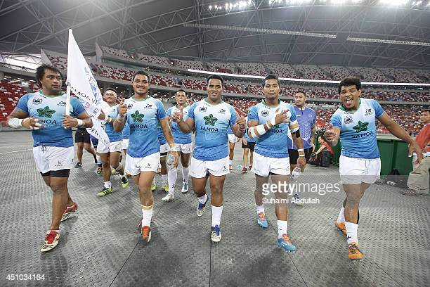 Players from Samoa Water President 10 celebrates after defeating London Welsh during the World Club 10s match at the National Stadium at the...