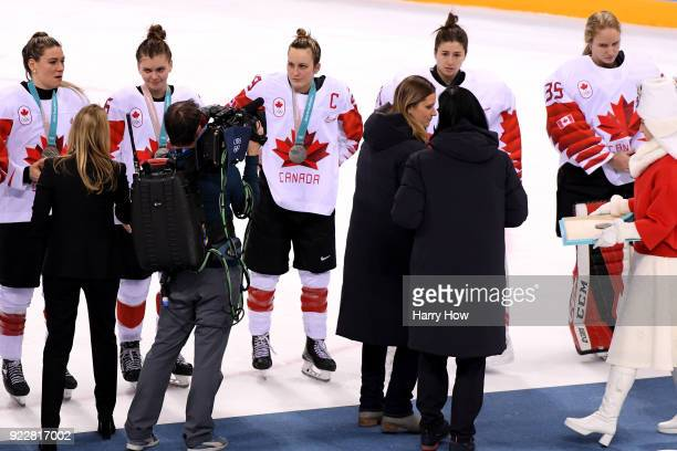 Players from Team Canada react after being defeated by Team United States 32 in the overtime penaltyshot shootout during the Women's Gold Medal Game...