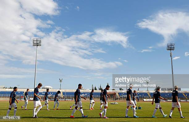 Players from team England warm up before the start of the match against Macedonia on October 27, 2014 in Paphos, Cyprus.