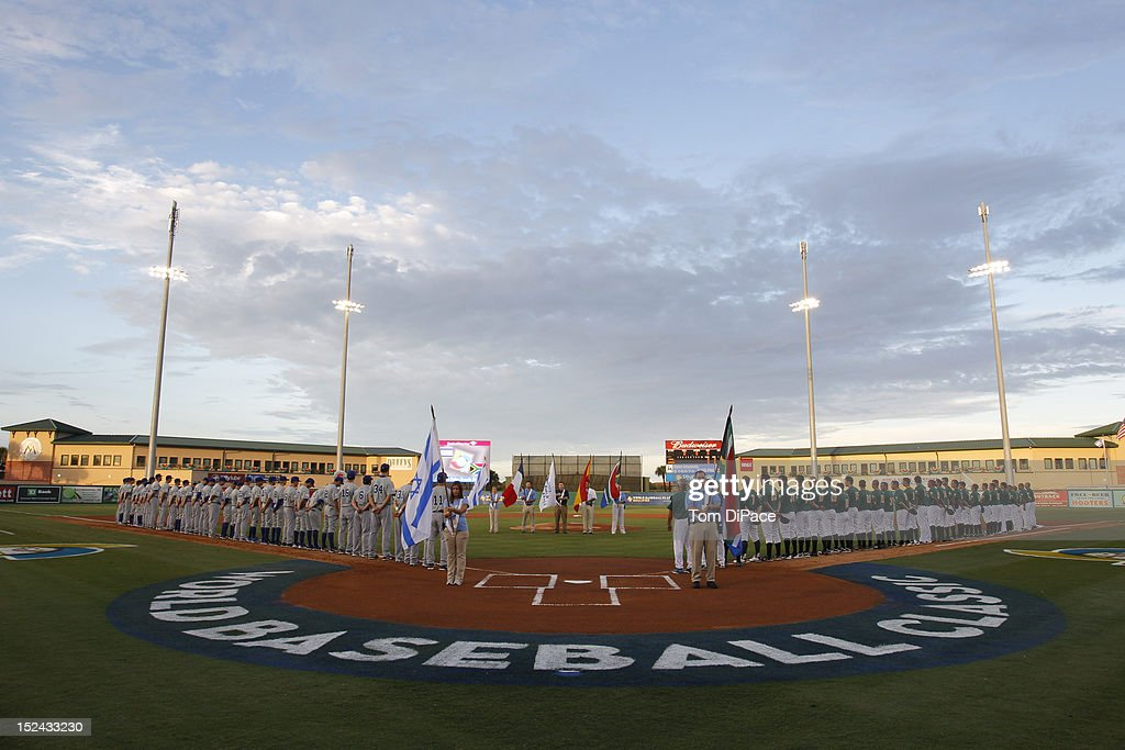 Players from Team Israel and Team South Africa line the base paths during the opening ceremonies of game one of the Qualifying Round of the World Baseball Classic between Team Israel and Team South Africa at Roger Dean Stadium in Jupiter, Florida, on Wednesday, September 19, 2012.