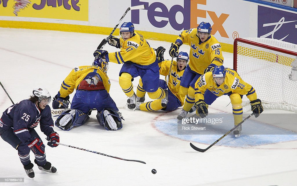 Players from Team Sweden scramble to cover the net as Justin Faulk #25 of the United States gets to the puck during the 2011 IIHF World U20 Championship Bronze medal game between United States and Sweden at the HSBC Arena on January 5, 2011 in Buffalo, New York.