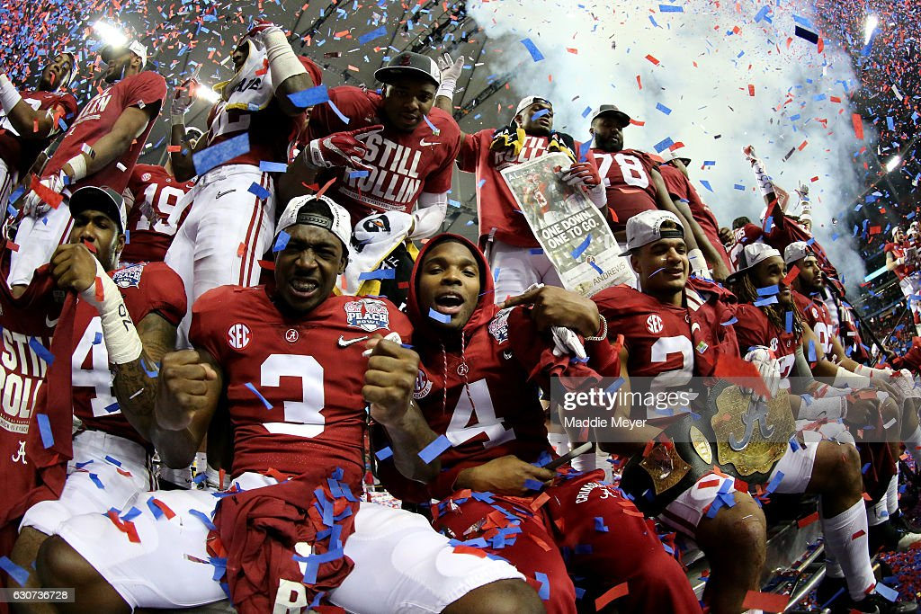 Players from the Alabama Crimson Tide celebrate after winning 24 to 7 against the Washington Huskies during the 2016 Chick-fil-A Peach Bowl at the Georgia Dome on December 31, 2016 in Atlanta, Georgia.
