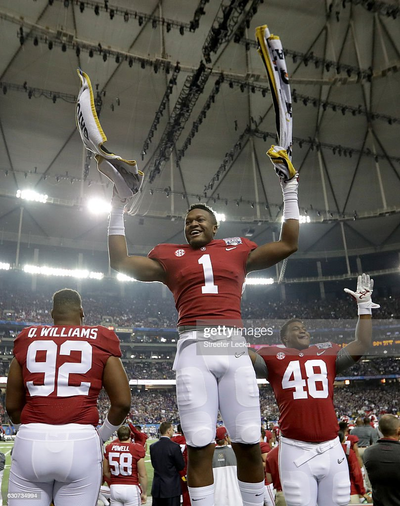Players from the Alabama Crimson Tide celebreate after beating the Washington Huskies 24 to 7 during the 2016 Chick-fil-A Peach Bowl at the Georgia Dome on December 31, 2016 in Atlanta, Georgia.