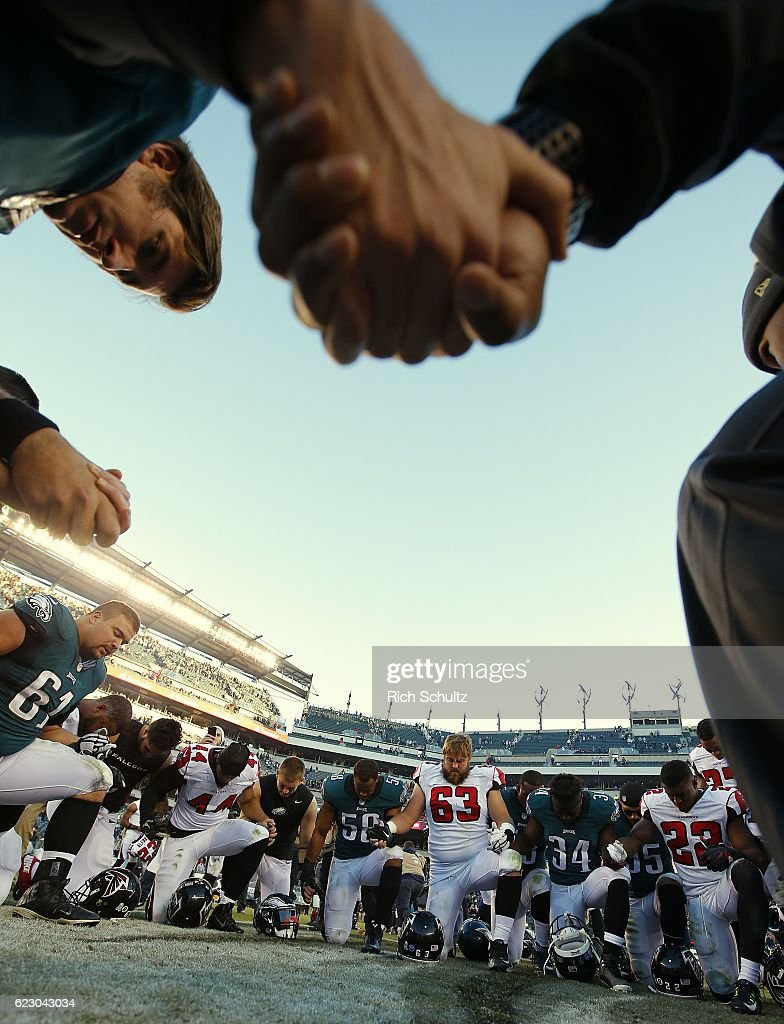 Players from the Atlanta Falcons and Philadelphia Eagles hold hands in a prayer circle after a game at Lincoln Financial Field on November 13, 2016 in Philadelphia, Pennsylvania. The Eagles defeated the Falcons 24-15.