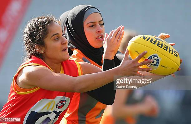 Players from the Auburn Giants compete for the ball during the women's AFL exhibition match at Melbourne Cricket Ground on June 14 2015 in Melbourne...