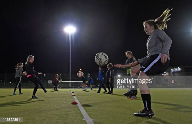 Players from the British Rail North End Social Club Ladies team take part in a training session at a leisure centre in Liverpool on March 5 2019 The...