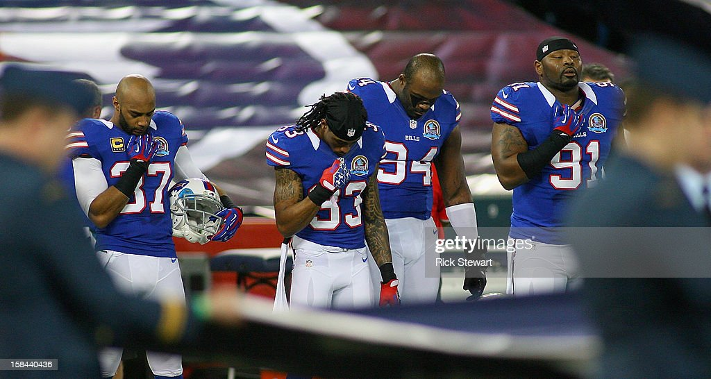 Players from the Buffalo Bills observe a moment of silence for the victims of the mass shooting at Sandy Hook Elementary School in Newtown, Connecticut, before a game against the Seattle Seahawks at Rogers Centre on December 16, 2012 in Toronto, Ontario, Canada.