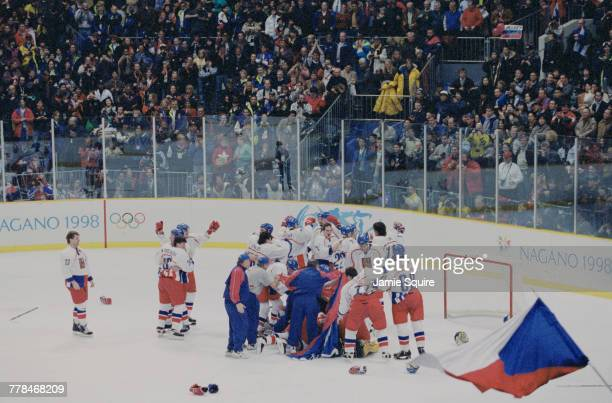 Players from the Czech Republic celebrate winning the Gold Medal game against Russia in the Men's Ice Hockey tournament on 22 February 1998 during...