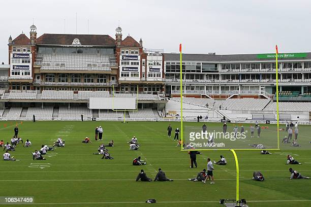 Players from the Denver Broncos warm up during a team training session at The Brit Oval on October 29 2010 in London England The Denver Broncos will...