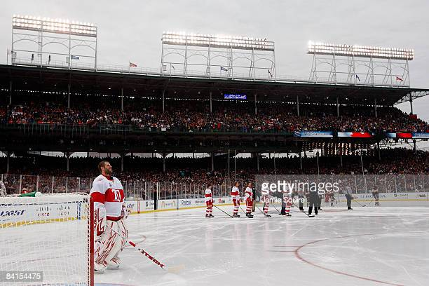 Players from the Detroit Red Wings and the Chicago Blackhawks stand for the National Anthem during the NHL Winter Classic at Wrigley Field on January...