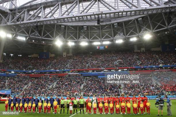 Players from the French and Belgium national sides line up before the 2018 FIFA World Cup Russia Semi Final match between Belgium and France at Saint...
