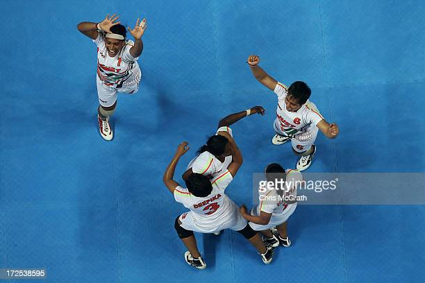 Players from the Independent Olympic Athletes celebrate winning the gold medal against Iran during the Women's Kabaddi Gold Medal match at Ansan...
