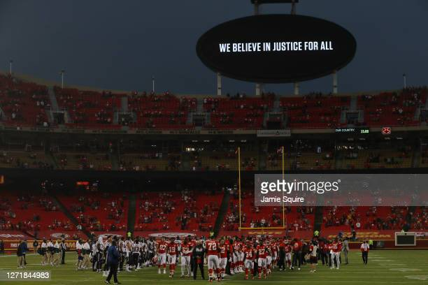 Players from the Kansas City Chiefs and Houston Texans unite in a moment of silence before the start of a game at Arrowhead Stadium on September 10...