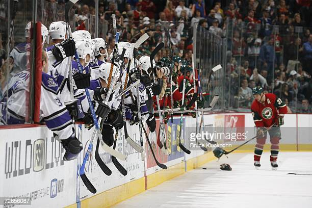 Players from the Minnesota Wild and the Los Angeles Kings bang on the boards with their sticks during a game at Xcel Energy Center on October 25 2006...