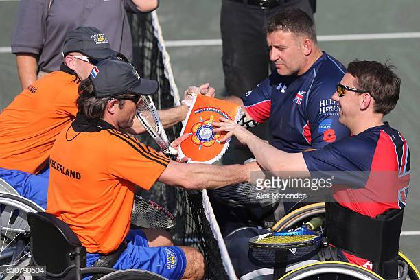 Players from the Netherlands and the United Kingdom greet each other at the net during the Invictus Games Orlando 2016 Swimming Finals at the ESPN...