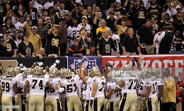 Players from the New Orleans Saints huddle up as their fans cheer them on prior to playing against the Minnesota Vikings at Louisiana Superdome on...