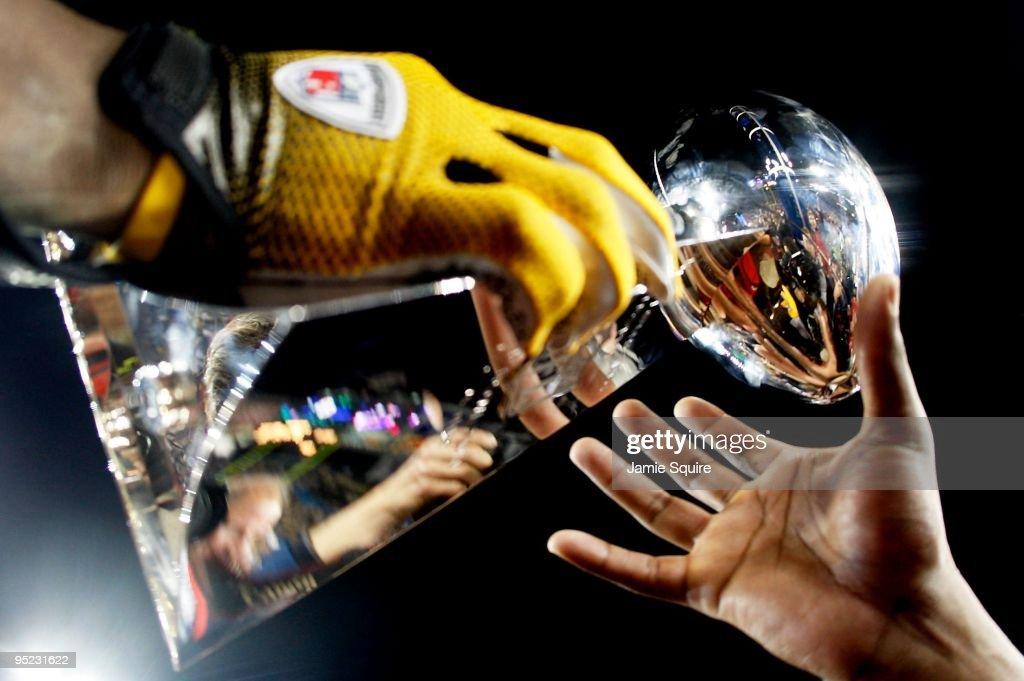 Players from the Pittsburgh Steelers celebrate with the Vince Lombardi trophy after their 27-23 win against the Arizona Cardinals during Super Bowl XLIII on February 1, 2009 at Raymond James Stadium in Tampa, Florida.