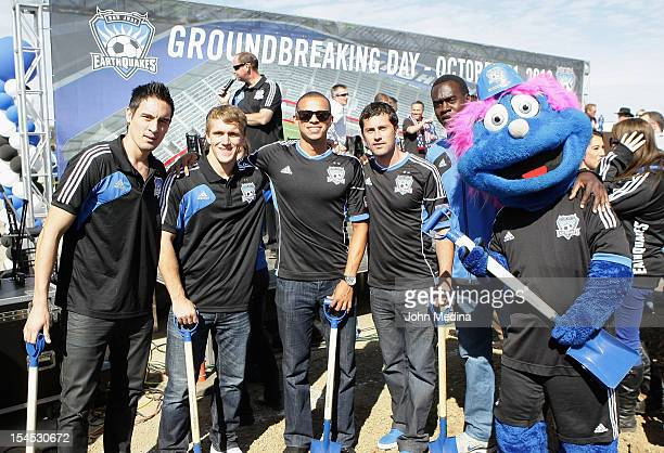 Players from the San Jose Earthquakes pose for a photo with team mascot Q during the groundbreaking ceremony on October 21 2012 in San Jose California