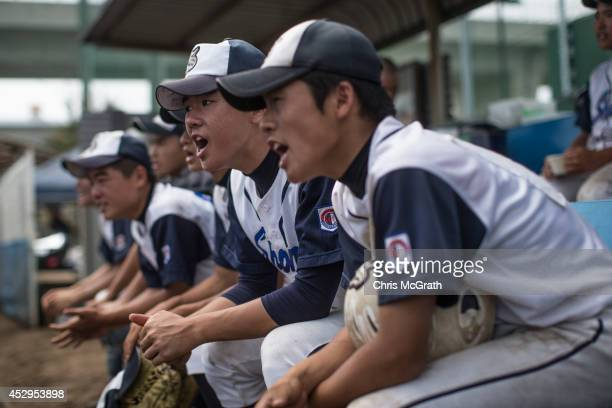 Players from the Shonan Boys yell instructions from the dugout during a practice game between the Shonan Boys and the Yokohama Minami on July 30 2014...