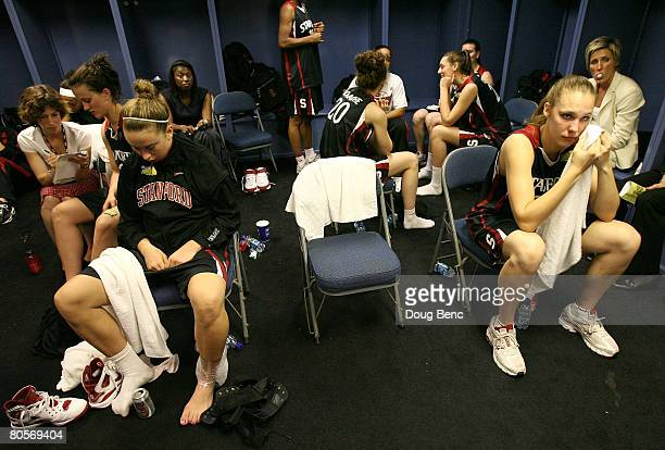 Players from the Stanford Cardinal sit in the locker room dejected after they lost 6448 against the Tennessee Lady Volunteers during the National...