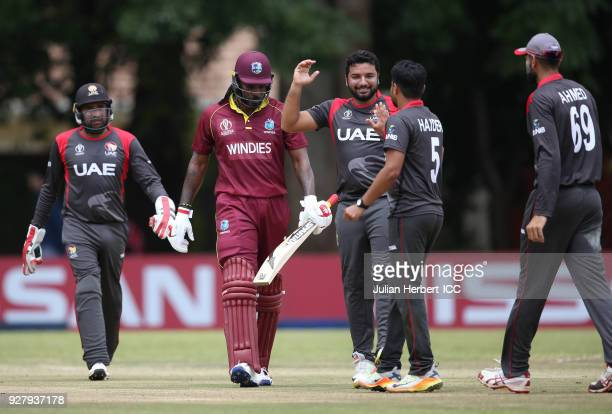 Players from The UAE celebrate the wicket of Chris Gayle of The West Indies during The ICC Cricket World Cup Qualifier between The West Indies and...