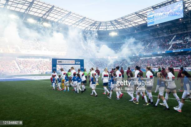 Players from the United States and Spain walk out with children for the start of the 2020 SheBelieves Cup match between United States and Spain...