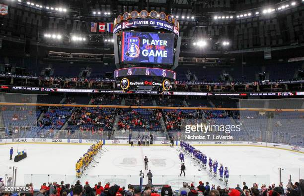 Players from the United States and Sweden wait for the player of the game to be announced following Sweden's 42 win over the United States in the...