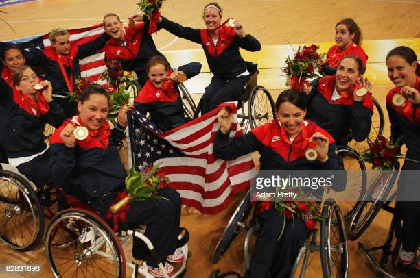 Players from the United States celebrate winning the Gold medal following the Women's Gold medal Wheelchair Basketball match between the United...
