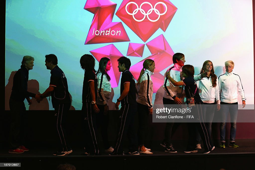 Players from the USA and Japan greet each other during the Women's Football Final press conference at the Main Press Centre as part of the London 2012 Olympic Games on August 8, 2012 in Newcastle upon Tyne, England.