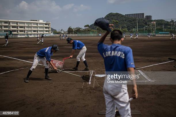 Players from the Yokohama Minami prepare the field for play during a practice game between the Shonan Boys and the Yokohama Minami on July 30 2014 in...