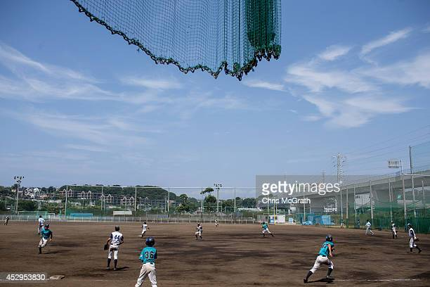 Players from the Yokohama Minami run between bases during a practice game between the Shonan Boys and the Yokohama Minami on July 30 2014 in Yokosuka...