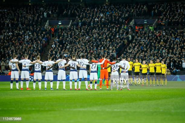 Players from Tottenham and Borussia Dortmund stand at the centre circle to remember Emiliano Sala and Gordon Banks during the UEFA Champions League...