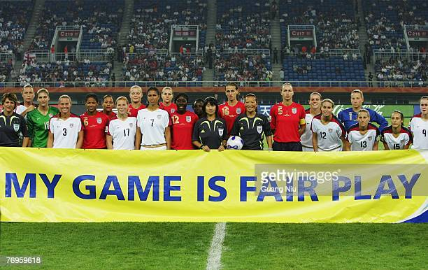 Players from USA and England stand behind a banner to support the FIFA Fair Play Days ahead the Women's World Cup 2007 quarter final match between...