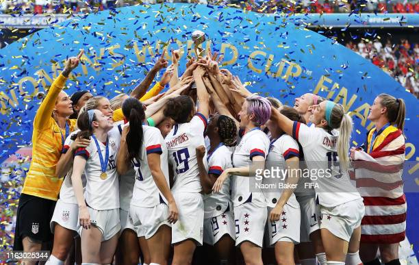 Players from USA lift the FIFA Women's World Cup Trophy following her team's victory the 2019 FIFA Women's World Cup France Final match between The...