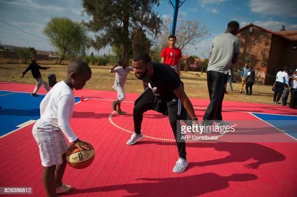 Players from various countries interact with children during a basketball clinic practice on the eve of the NBA Africa Game 2017 basketball match...